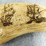 image of Whale Tooth Engraved with War of 1812 Battle