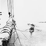 image of Four Whaleboats Towing Whaling Schooner <em>Era</em>