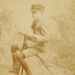 image of Portrait of a Young Boy on a Tricycle