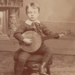 image of Cabinet Photograph, Young Boy Playing Banjo